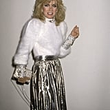 Donna Mills rocks her soft and shiny ensemble at Billy Wilder's 1987 New Year's Eve party at Spago's.