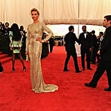 Cameron Diaz wore a gold Stella McCartney design to the Met Gala.