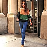 Layering a colorblock sweater over a gingham shirt, she nailed preppy-cool in September 2011.