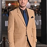 Justin Timberlake in a tan suit.