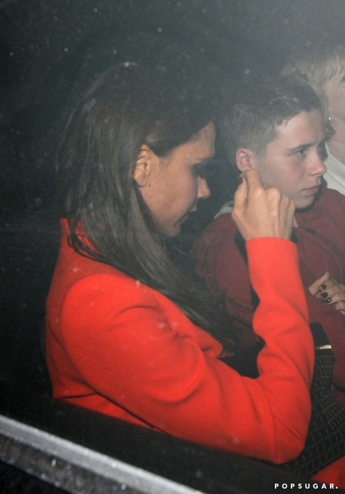 Victoria Beckham wore a bright orange jacket to her birthday dinner in London.