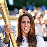 "Mel C., aka ""Sporty Spice,"" of the Spice Girls held the Olympic torch in Birkenhead, England."