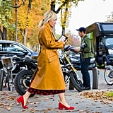 Wear a Mustard Yellow Coat With a Printed Dress and Red Heels