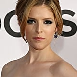 Dramatic black eyeliner was a popular makeup choice of the night, and Anna Kendrick paired hers with a pretty, feminine updo.