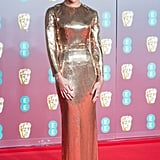 Zoë Kravitz looked like a trophy in a gold custom full-length Saint Laurent gown at the 2020 BAFTAs.