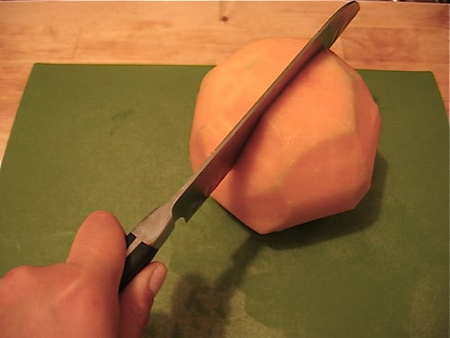 Cut the shaved cantaloupe in half crosswise.