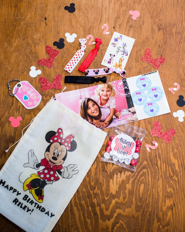 Custom goody bags were created by Sweet Lily's Confections and included confetti, Minnie Mouse hair ties, and personalized labels from Mabel's Labels.