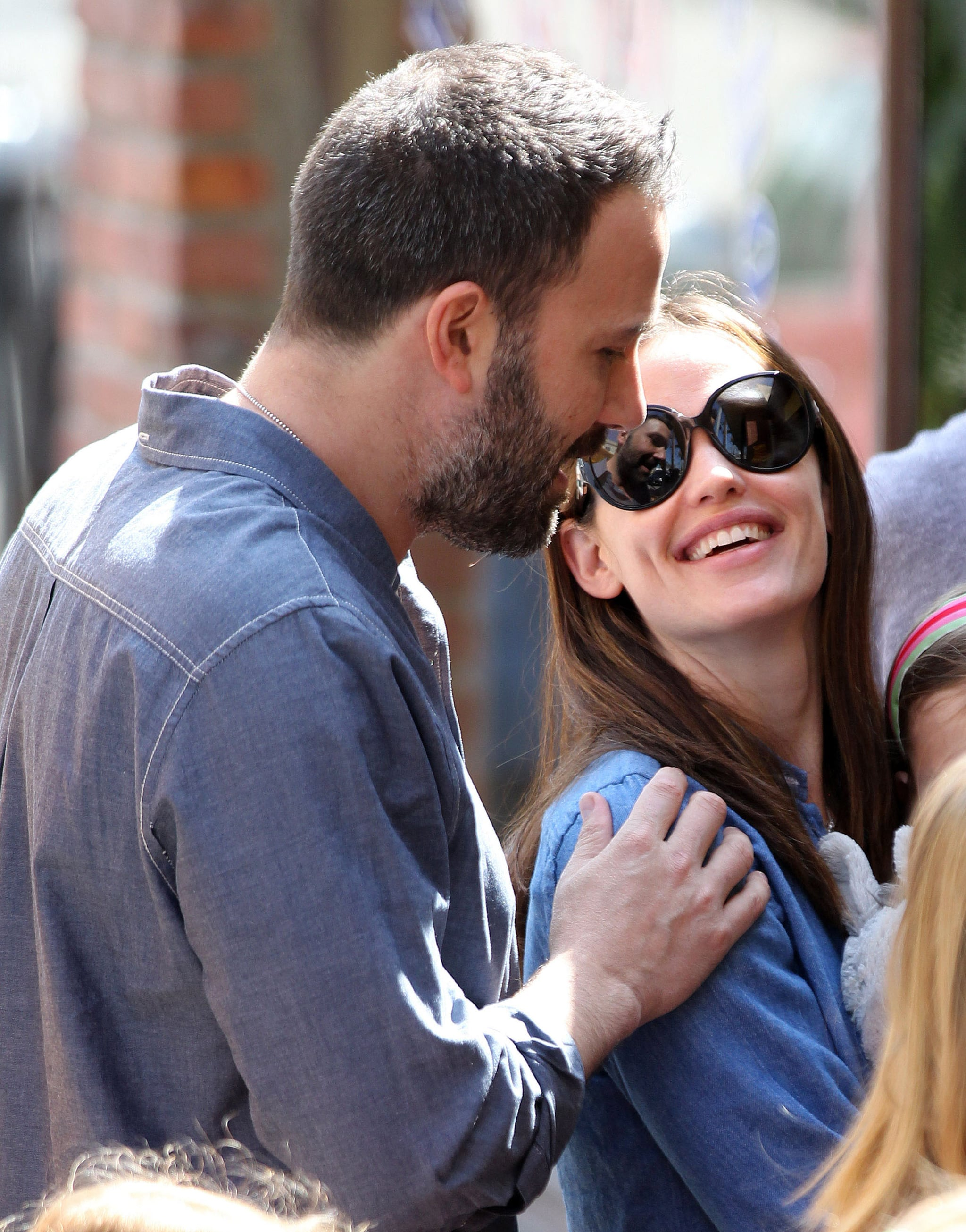 Ben Affleck put his hand on Jennifer Garner's shoulder during a family outing in Pacific Palisades in March.