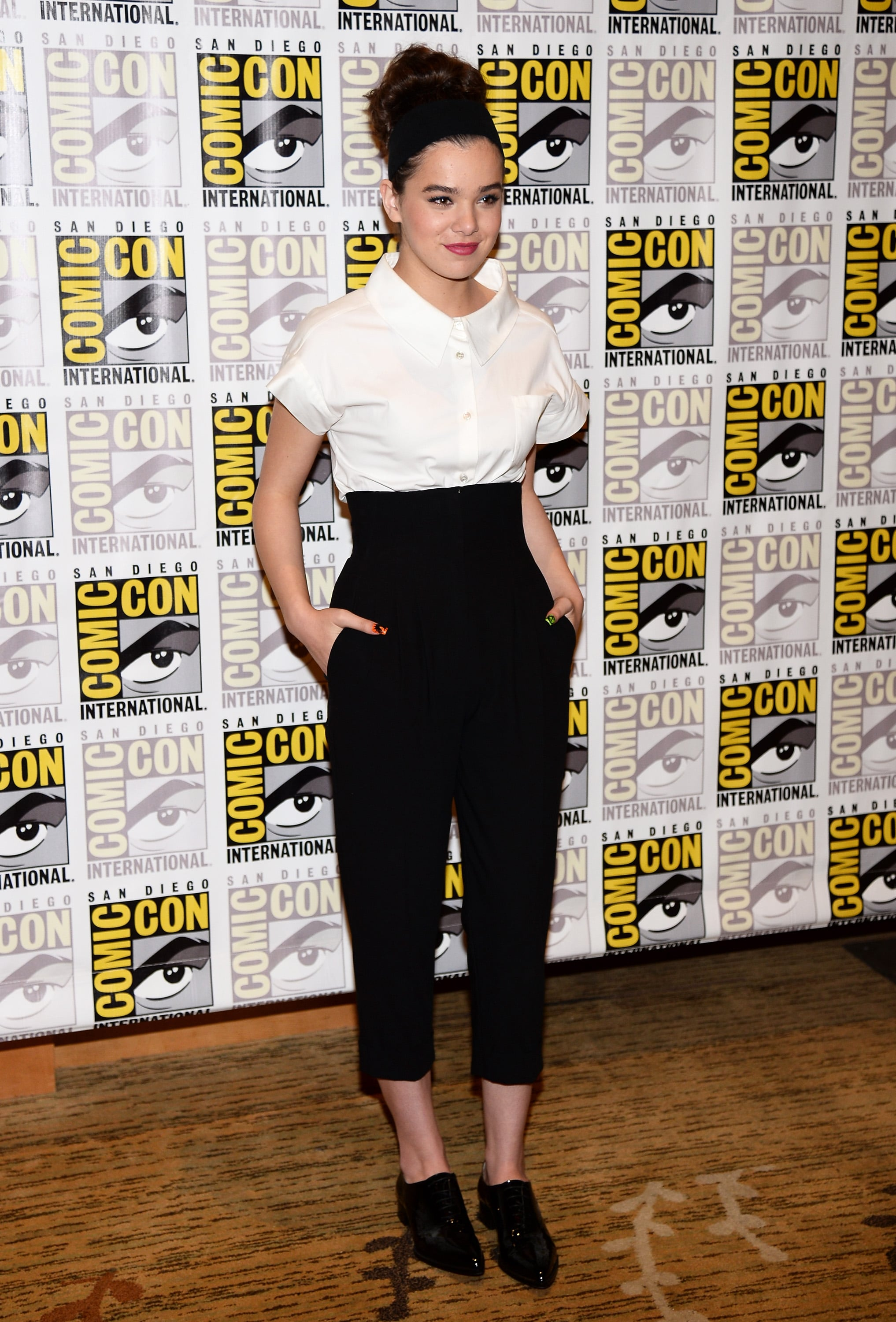 Steinfeld paired a crisp, short-sleeved white shirt with high-waisted cropped black trousers (both by Michael Kors) and a pair of Christian Louboutin flats at a press conference for Ender's Game and Divergent.