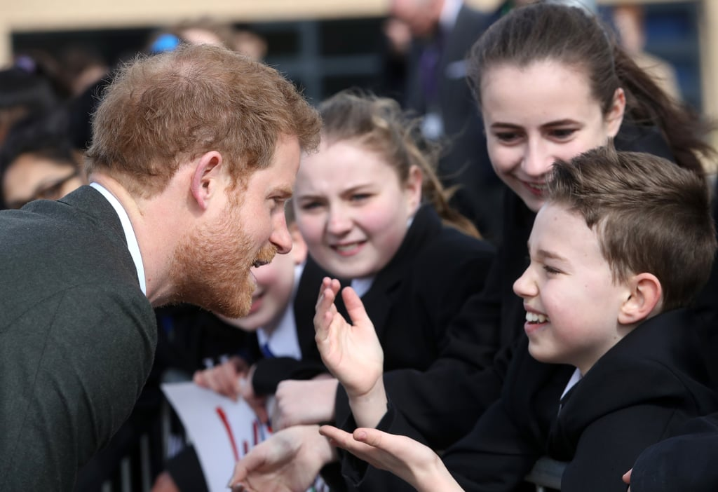"""Prince Harry has amassed quite a fan club over the years, and when you take into account how easy he is on the eyes and his, um, impressive physique, it's not hard to see why. Of all the charitable royal's many admirers, few have been as excited to see him than the students of Hamilton College in Leicester. Harry was more than happy to stop and chat with the teenagers on his way out of their school on Tuesday, shaking hands and goofing off the whole time. A few girls even brought a big """"We Love You Prince Harry"""" sign with them, forever cementing them as our personal heroes. It looks like Harry's girlfriend, activist and actress Meghan Markle, might have some competition on her hands, huh?  Meeting his adorable young fans aside, it's been a busy few weeks for Prince Harry. While decades-old rumours about the truth of his paternity were dredged up due to a new interview with Princess Diana's old flame, James Hewitt, Harry kept his head down and continued working on the causes closest to his heart. A trip to Epping Forest and his appearance at a special ceremony at the Embassy of Nepal are just the start of many more exciting, philanthropic engagements he and the rest of the royal family have on their schedule for 2017.      Related:                                                                                                           Prince Harry Takes a Break From His Royal Duties to Delight a Young Fan"""