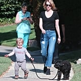 January Jones let her son, Xander, take their little dog for a walk in LA.