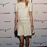 Gwyneth Paltrow wore shades of white and bright red pumps.