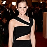 Emma Watson donned thick eyebrows and some dark lined eyes to add drama to her sexy dress.