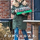 Michelle Williams carried gifts and flashed a smile in Brooklyn, NY, on Sunday.
