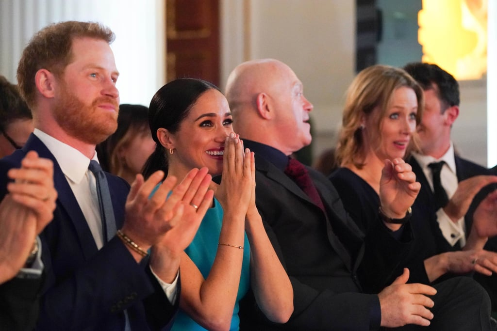 """Proposals usually require some kind of grand gesture, and what could be more memorable than getting engaged in the presence of Prince Harry and Meghan Markle? OK, I know you're probably thinking right now, """"How do you even make that happen?"""" Well, it's easy: you just have to show up to the same event as them. On Thursday, Meghan and Harry attended this year's Endeavour Fund Awards in London, where one of the night's winners Danny Holland seized the opportunity and proposed to his girlfriend on stage after being honored with the recognizing achievement award. As cameras panned to the audience, the Duchess of Sussex was shown putting her hands  over her heart and taking in the sweet moment with Harry. The couple even included it in their Instagram video from the event!  The Endeavour Fund was launched by Harry in 2012 when he was a patron of The Royal Foundation, and it supports wounded, injured, and sick servicemen and assists in their recovery. It marked Meghan's third time at the ceremony and the couple's first joint public appearance since announcing their royal exit. See the special moment ahead.       Related:                                                                                                           Helen Mirren Defends Meghan Markle After Royal Exit: """"Their Instincts Were Absolutely Correct"""""""
