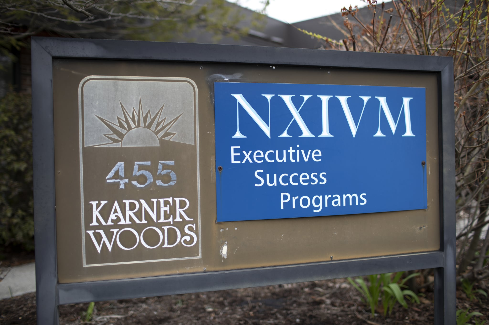 ALBANY, NY - APRIL 26: The NXIVM Executive Success Programs sign outside of the office at 455 New Karner Road on April 26, 2018 in Albany, New York. Keith Raniere, founder of NXIVM, was arrested by the FBI in Mexico in March of 2018. (Photo by Amy Luke/Getty Images)