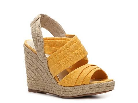 A pop of color paired with an espadrille wedge — your new Spring sole mate. Ann Marino Jillian Wedge Sandal in Yellow ($50)