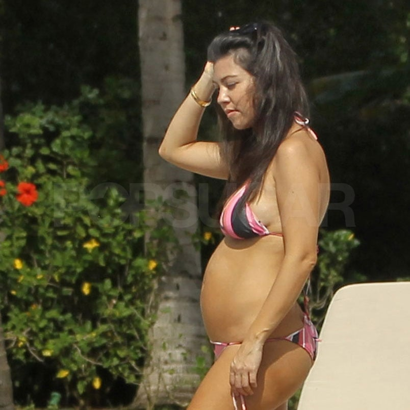 Kourtney wore a striped bikini.