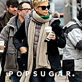 Charlize Theron carried a coffee onto the Boston set of Hatfields & McCoys.