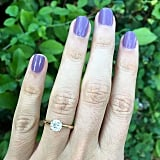 """1. Get a Manicure You want your beautiful ring to be the focus of the photos, not your chipped nail polish and ragged cuticles. A soft pink polish is always a safe choice, but don't be afraid to choose a bold color that reflects your personality instead. You can also add an accent, like a crystal or an overlay, on your ring finger to really make it pop. Make sure to moisturize your hands right before the picture, and try this trick for picture-perfect hands: """"Hold your hand up and count to 12 before moving into the perfect position; your veins and arteries will be less noticeable, and your skin tone will look less red. This is a longtime trick of hand models,"""" suggests LaFonn Jewerly."""