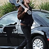 Ryan toted his guitar over his shoulder while walking in LA in 2008.