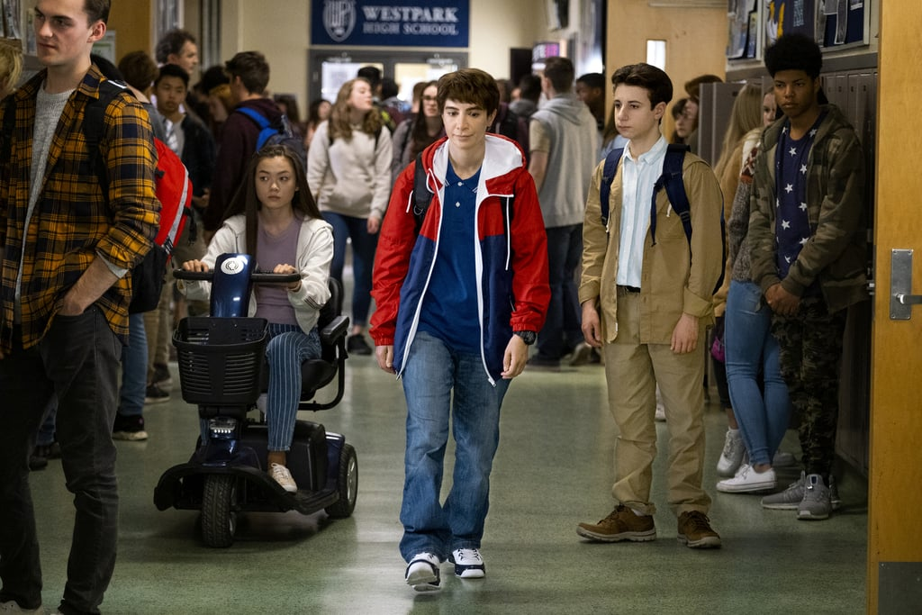 """New TBS comedy Chad is about the trials and tribulations of a 14-year-old boy who's trying to fit in at school. But when you look closer, you'll quickly realize that something's a little different about the title character. Mainly, he's not a 14-year-old boy at all — he's a 39-year-old woman. Played by SNL veteran Nasim Pedrad, who also conceptualized the show and created its lovable cast of characters, from Chad's idol Reid (Thomas Barbusca) to his single mom Naz (Saba Homayoon), Chad is anything but ordinary.  We'll admit, it's a tiny bit absurd watching Pedrad work her comedy magic to bring an awkward adolescent to life, but that's kind of the whole point of the show. According to costume designers Amanda Needham and Adejoké Taiwo, the idea wasn't to completely fool viewers into thinking Pedrad was an actual young boy, but create that likeness so that the audience could get lost in the story and simultaneously feel like they were in on the joke. """"It's an adult bringing the point of view of a teenager after growing up,"""" Needham tells POPSUGAR.  Here, we talked to Needham and Taiwo about what it was like dressing a full-grown woman as teenage boy, the biggest trends of the moment, and how the immigrant experience played a part in the costume design. POPSUGAR: Dressing a 39-year-old woman as a 14-year-old boy is a pretty Herculean task. What was your biggest challenge? Amanda Needham: Well, we wanted to obviously compress [Pedrad's] lady parts, but sometimes, you still get a bump, or you get a sports bra line. You want to submerge people in the storyline, but if you see the bra, it takes you out of it. Being a designer, you have a higher sensitivity to it. So it was really about just trying to create comfort and reduce those lines that you'd see.  Adejoké Taiwo: That was a problem when we were shooting — if we saw the [bra] line or if the garments were lighter colors. We really had to be cautious with that.  PS: How did your previous work on other TV shows help prep"""