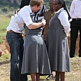 Harry embraced a woman at the Kananelo Centre for the deaf in Lesotho in 2013.