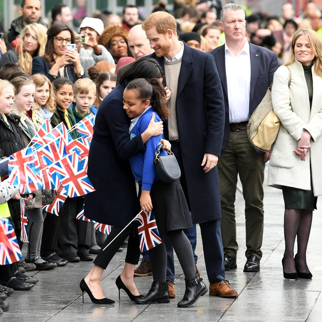 Prince Harry and Meghan Markle took time out from wedding planning to make a visit to Birmingham, England, on Thursday, and it's safe to say the residents of the second city gave them a warm welcome. Crowds of local schoolchildren greeted the royal couple, waving union flags in welcome, and Meghan wasted no time in crouching down to shake their hands and chat. She even went in for a full-on hug with a couple of lucky kids. Harry, meanwhile, seemed more interested in an adorable dog he spotted in the crowd.       Related:                                                                                                                                A Must-Watch: Meghan Markle Gives Inspiring Advice to a 10-Year-Old Girl Who Wants to Be an Actress               The couple's whistle-stop tour of the city included a visit to the youth project including STEMettes, a social enterprise group that encourages girls to get involved in science, technology, engineering, and mathematics. The couple got hands on with some VR headsets, and spent time with girls who are learning to code and build apps. There could be no more fitting choice for the couple on International Women's Day! Take a look at the best photos from their day now, get details on Meghan's coat and sweater, and bag, and stay tuned for more.