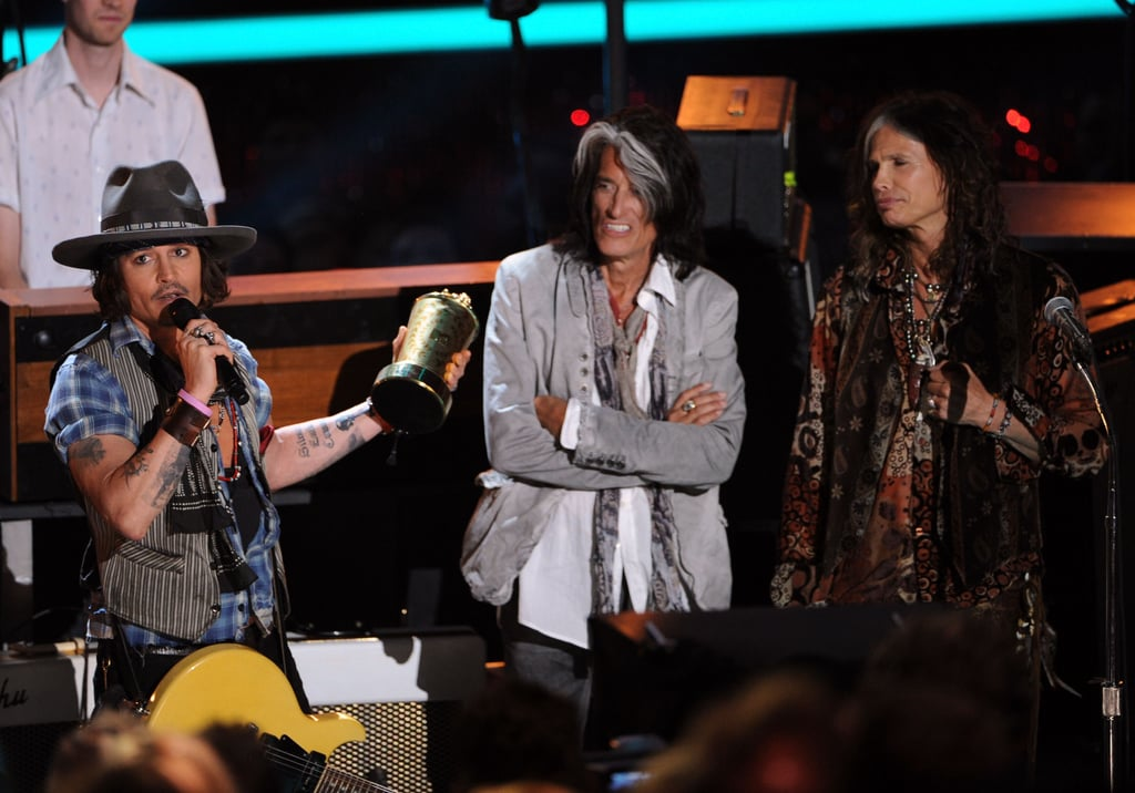 Aerosmith took the stage with Johnny Depp while he accepted this year's generation award.