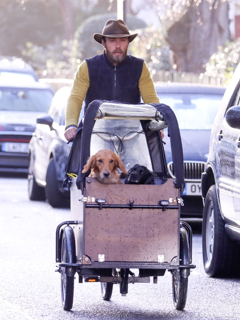 """James Middleton, younger brother of Kate and Pippa and devoted dog dad, was spotted taking his furry friends for a ride on a special dog bicycle through the Chelsea neighborhood of London last week. The handsome 31-year-old businessman had two of his five dogs in tow for the cruise, and everyone seemed to really be enjoying the wind blowing through their hair.  Since James graciously made his Instagram public last month, we've gotten a nice glimpse at his life in England, including his love for his pets. In January, James opened up about how much his dogs have helped him battle depression in an op-ed for The Daily Mail. """"I recognize, too, the role my dogs — Ella, Inca, Luna, Zulu and Mabel — have played in my recovery,"""" James wrote in the emotional piece. """"Ella, particularly, has been my constant companion for ten years and she's been with me to all my therapy sessions. In her own particular way, she has kept me going."""" Scroll through for more photos of James and his adorable bike ride.      Related:                                                                                                           Kate and Pippa Are Great, but Their Hot Brother James Middleton Deserves His Own Crown"""