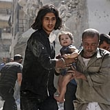 Volunteers rescue a child after an airstrike in a rebel-held neighborhood of Aleppo.