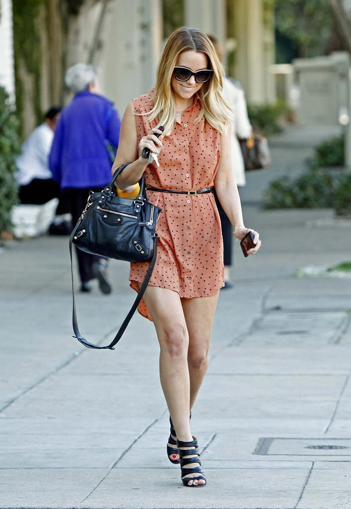 Lauren took in a day of errands in 2013, looking cute and enjoying the warm LA weather in a MINKPINK shirtdress and Christian Louboutin heels. Lesson from Lauren: give structure to a printed shirtdress with a thin belt.