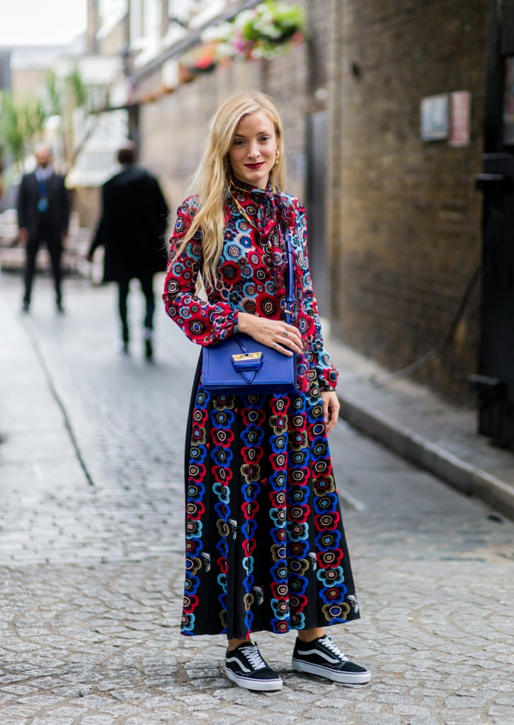 With a Long-Sleeve Floral Dress and Matching Purse