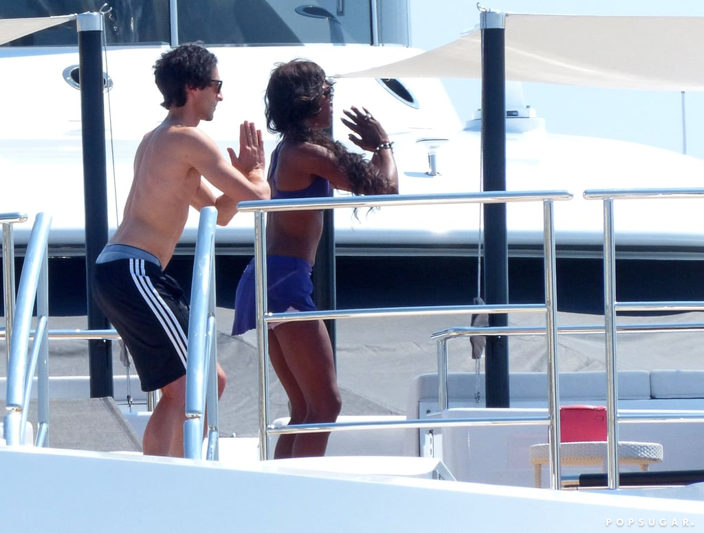 Naomi Campbell wore a purple sports bra while Adrien went shirtless.