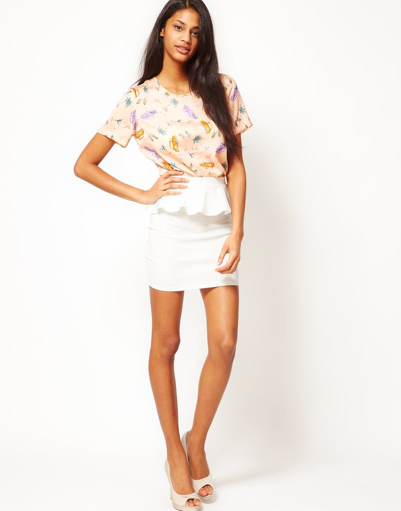 Peplum was a huge trend on the Spring runways, and this white skirt would look great with a solid-colored tank tucked in.  Oh My Love Peplum Mini Skirt ($43)