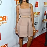 Zoe Saldana stepped out in a blush-toned fit-and-flare dress with an embellished pair of ankle-strap pumps.
