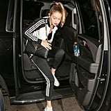 Gigi wearing an Adidas track suit.