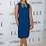 Rashida Jones accessorized an understated Calvin Klein sheath with statement-making Dannijo jewels and lace-up platforms.