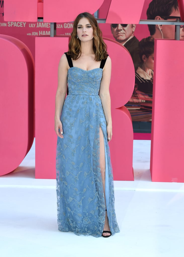 Fashion It girl Lily James stepped out on Wednesday night in a look to rival her Met Gala ensemble at the premiere of Edgar Wright's Baby Driver. The actress kept things British in a beautiful blue embroidered Burberry gown paired with black sandals, drop earrings, and a leg slit that screamed Angelina Jolie. Although Lily's beau, Matt Smith, wasn't present, she was in good company beside the film's handsome lead, Ansel Elgort. Read on to see Lily's dress from all angles along with her best Angie impression.
