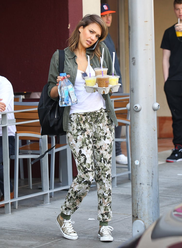 Jessica Alba balanced six drinks and a cell phone while running errands in Beverly Hills on Sunday.