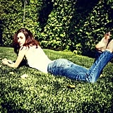 Emmy Rossum enjoyed a sunny day by relaxing in the grass. Source: Instagram user emmyrossum