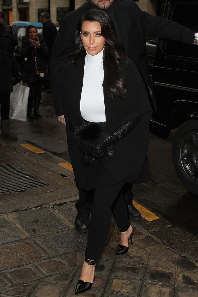 Kim Kardashian continued her menswear-inspired tuxedo-suit streak with yet another black and white look as she arrived at the Stephane Rolland Couture show.