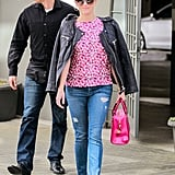 Reese coordinated her pink bag, shoes, and top, but added edge with a leather jacket for a day out in LA.