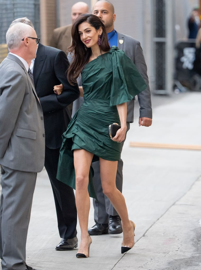 "Amal Clooney accompanied her husband George to the premiere of his latest project, Catch-22, on Tuesday night. The actor celebrated his 58th birthday the day before, and it seems like they wanted to keep the party going, as Amal chose to wear a suitably festive ensemble for their sweet date night. Amal's Oscar de la Renta dress was the perfect retro party dress, with its mini hemline, asymmetrical neckline, and oversize bows on the shoulder and hip.      Related:                                                                                                           Amal Clooney's Best Outfits of the Year Could Last Us a Whole Lifetime               We couldn't help but get some serious '80s flashbacks as we admired Amal's look, especially as the fabric is a crinkled taffeta, the ultimate ""remember when?"" throwback. Amal kept it looking up to date by teaming it with streamlined accessories: a pair of black pumps with perspex inserts and a small box clutch. Take a closer look at her party-ready ensemble ahead, and shop that statement party dress for yourself."