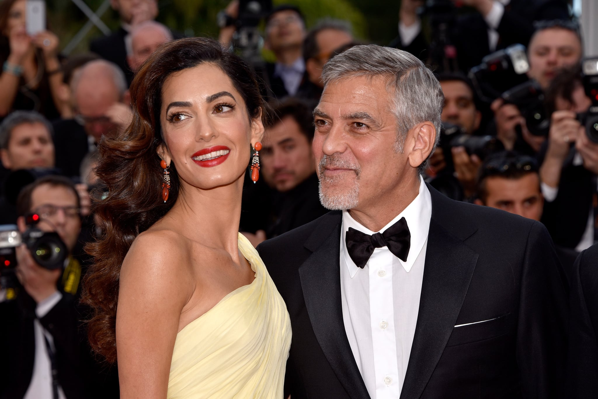 CANNES, FRANCE - MAY 12:  Actor George Clooney and his wife Amal Clooney attend the