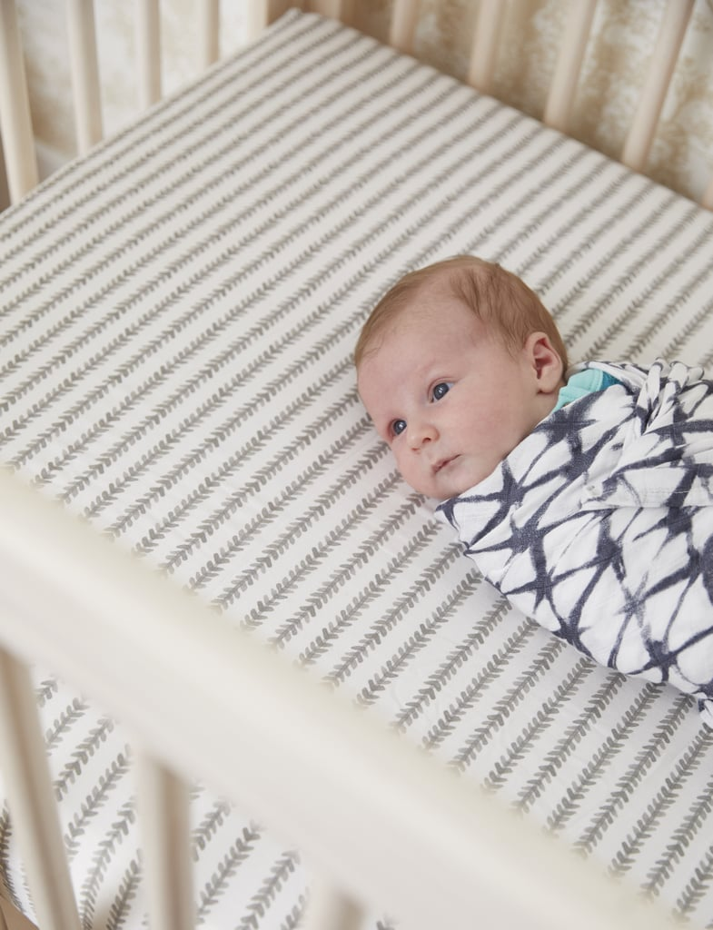 Sonny's modern crib is accented with a hip neutral-printed sheet, big on personality yet perfect for a boy or girl.