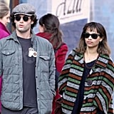 Penn Badgley and Zoe Kravitz walking in NYC.