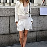 This styler toughened up a white-on-white mix with edgier footwear.