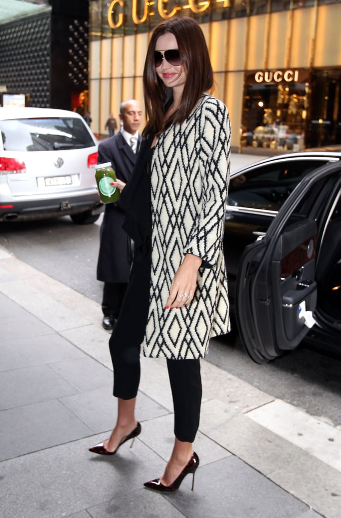 Miranda made a statement in a standout coat but kept it all understated underneath.