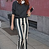 Add a subtle point to wilder prints á la Taylor Tomasi Hill's vertically striped pants-and-pumps combination.
